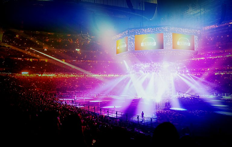Concert Stage With Shining Lights And Crowd At A Performance. Ro